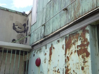mint green rusted building