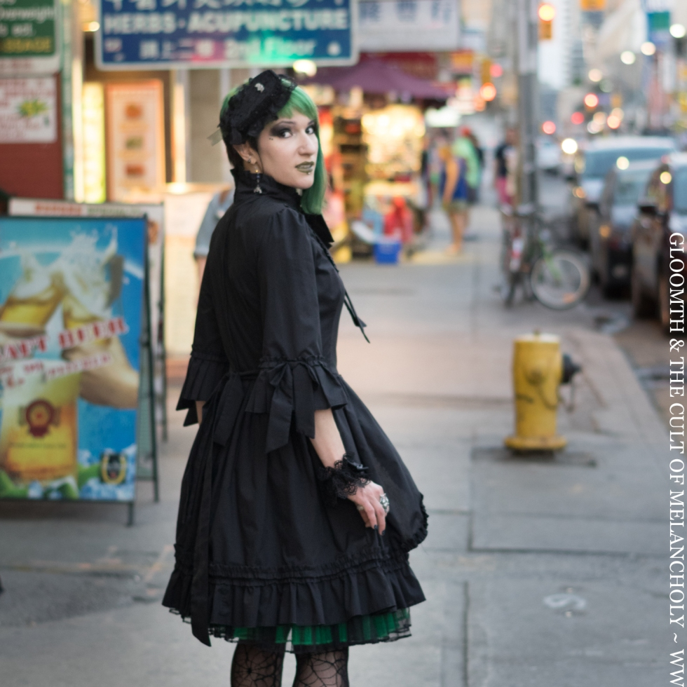 gothic victorian dress on a city street