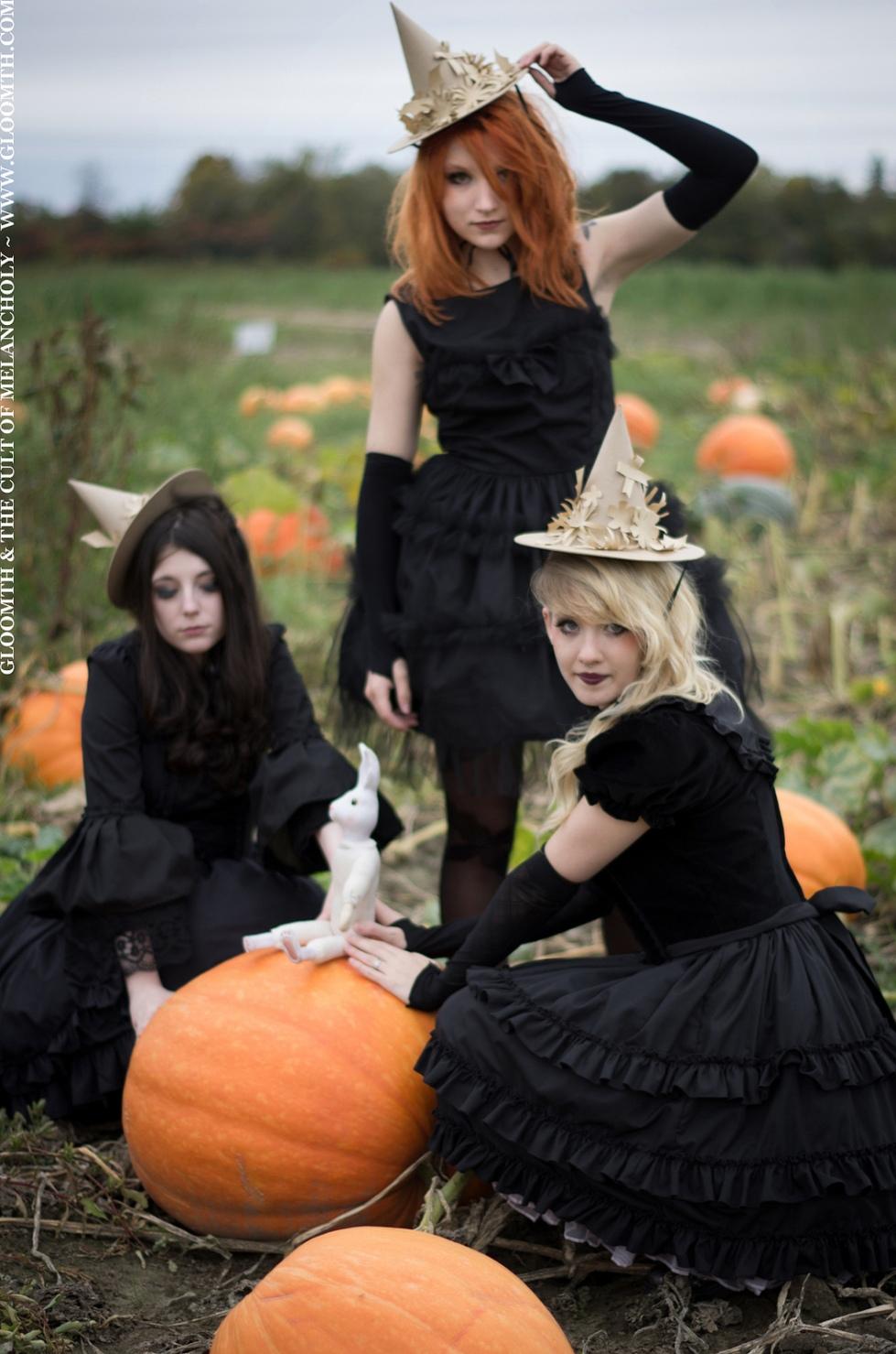 gothic girls witch in pumpkin patch
