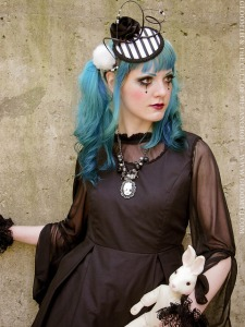 gothic outfit with taissa lada striped fascinator hat