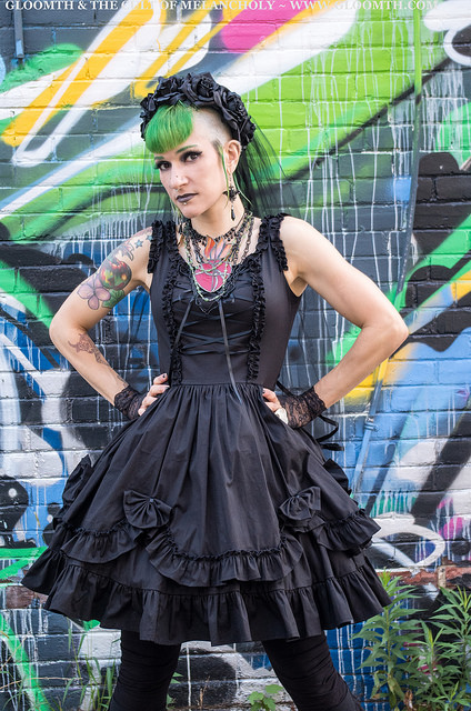 gothic model against a colorful graffiti wall background toronto