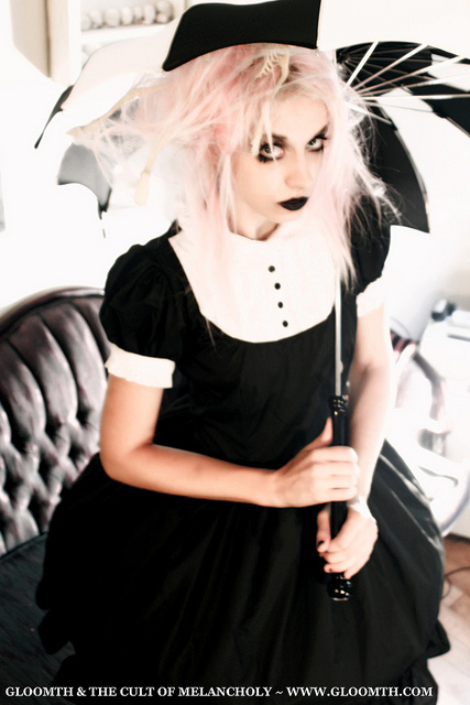 gothic halloween photoshoot with pink hair model and black and white lolita dress