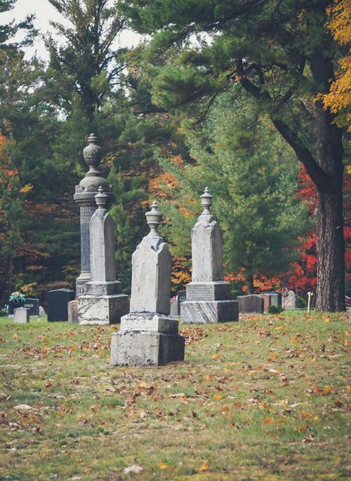 victorian tombstones in autumn graveyard cemetery