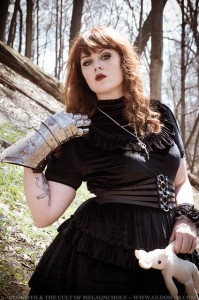 photo of an alternative model in a black velvet gothic dress with a metal gauntlet