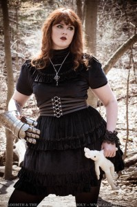 black velvet dress on a plus size model with steel armor gauntlet