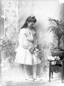 victorian girl in white communion dress