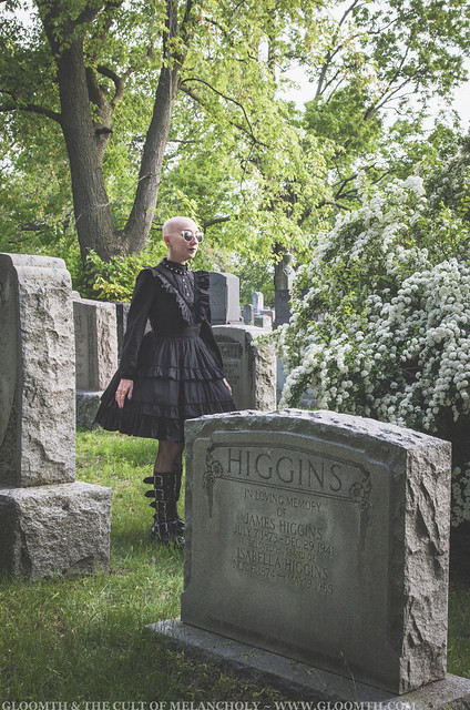 gothic victorian mourning dress in graveyard