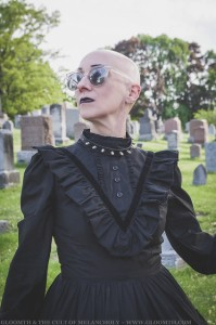 bald gothic woman in victorian dress