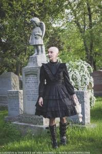 bald gothic wioman in victorian cemetery