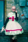 bald gothic woman in a nurse dress