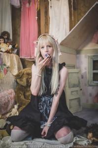 creepy dollhouse girl