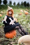gothic girl in pumpkin patch