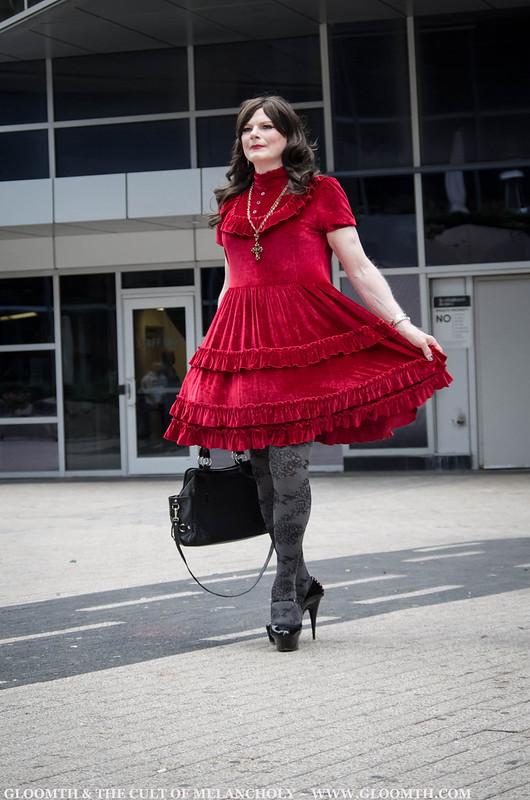 drag queen in red velvet gothic dress 1