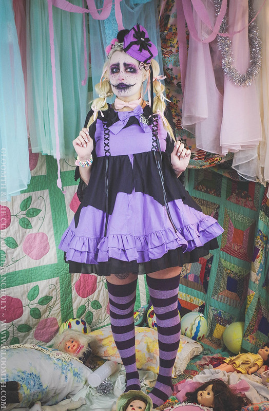 Creepy Kawaii Clown Girl in a purple and black dress. Jazmin bean makeup