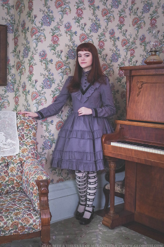 victorian girl beside a piano