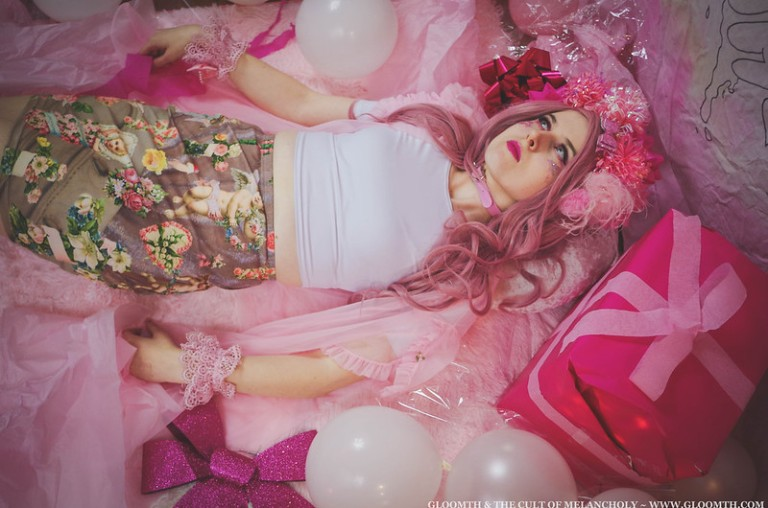 kawaii girl in a pink room