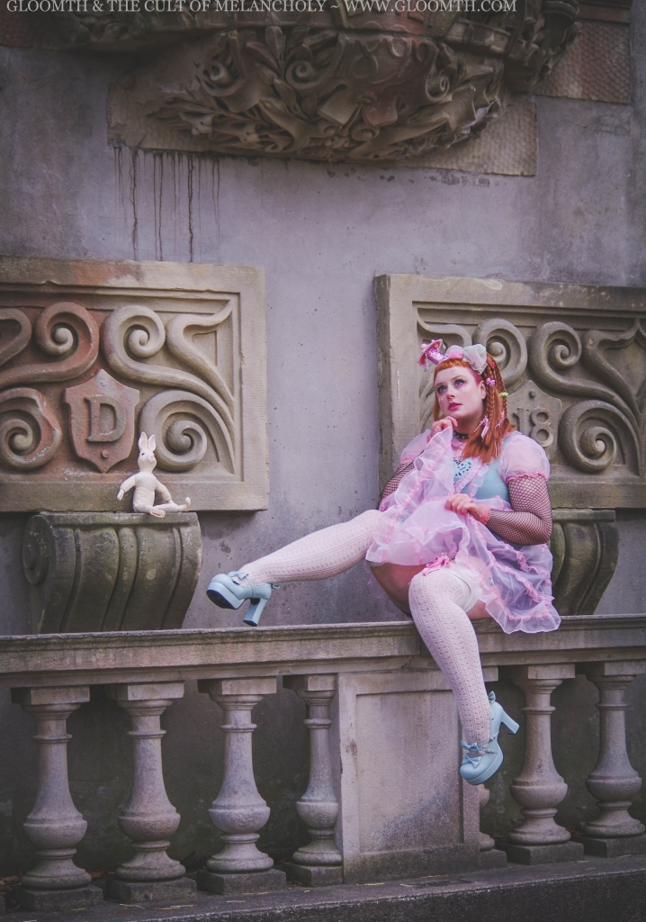 plus size lolita in a sheer pink dress